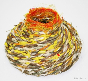 Basket 'Autumn' by Meredith Peach, made from mixed reclaimed materials and natural fibres